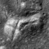 "Fractured mound in Stevinus crater forming an ""X"""