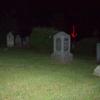 Face in headstone