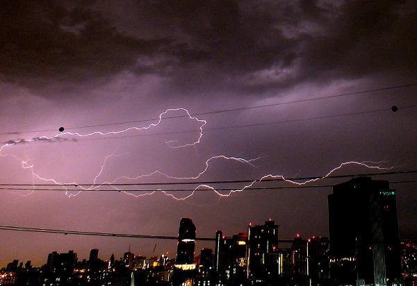 Lightning (Man) Crawls Along Powerlines