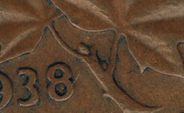 Alien on a 1938 1 cent Canadian .