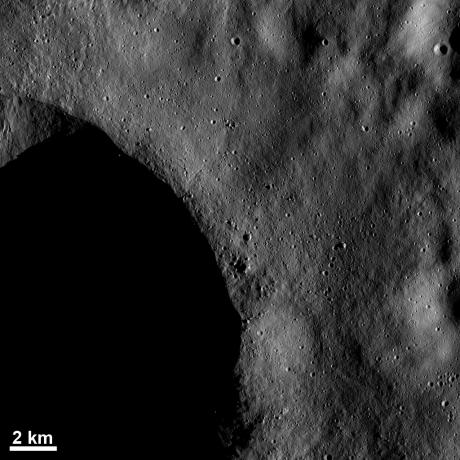 Vesta - Blocks of ejected material and small craters near a crater rim