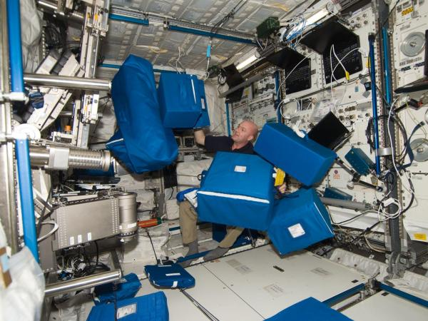 International Space Station - Astronaut Andre Kuipers With Stowage Containers