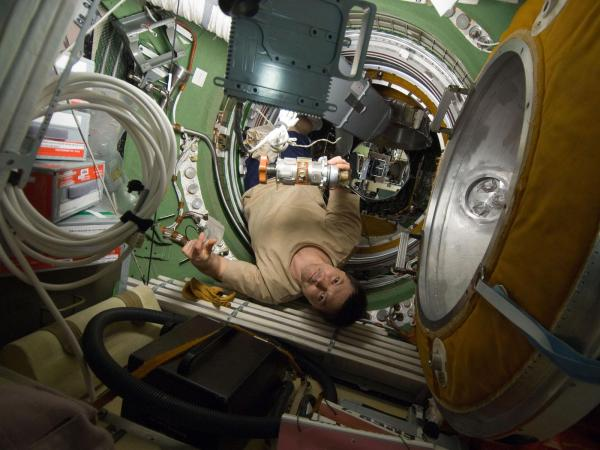 International Space Station - Cosmonaut Kononenko in Transfer Compartment
