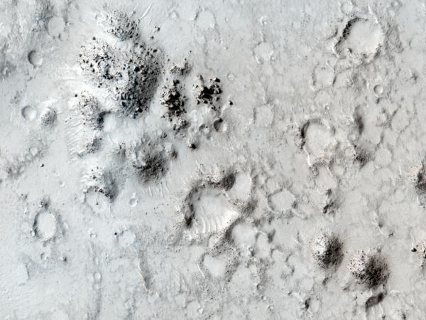 Mars Reconnaissance Orbiter - Eroded Terrain Near Volcanic Fissures