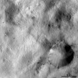Vesta - Spots of dark material surrounding an impact crater