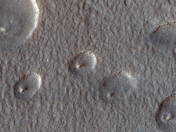 Mars Reconnaissance Orbiter - Expanded Craters on Icy Terrain