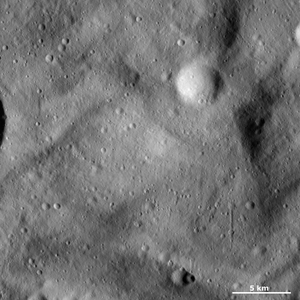 Vesta - Undulating surface and secondary crater chains