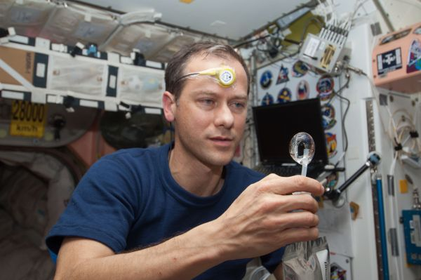 Astronaut Tom Marshburn With Water Bubble