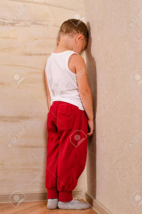 31182476-little-boy-standing-in-a-corner-sulking-turning-to-watch-behind-him-with-an-angry-morose-expression-.jpg