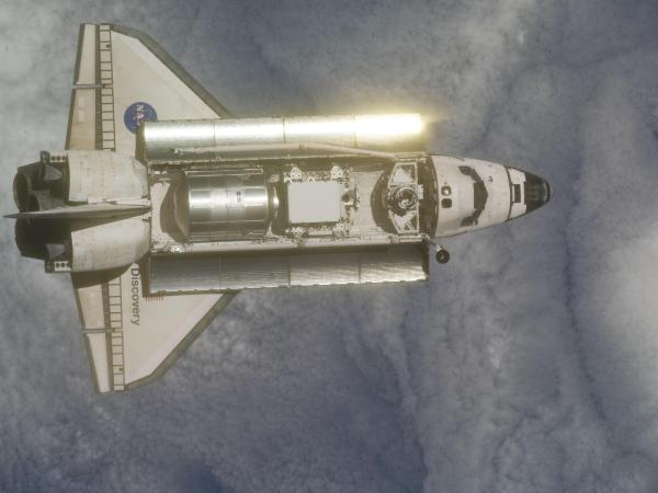 Sunlight - Space shuttle Discovery during STS-133