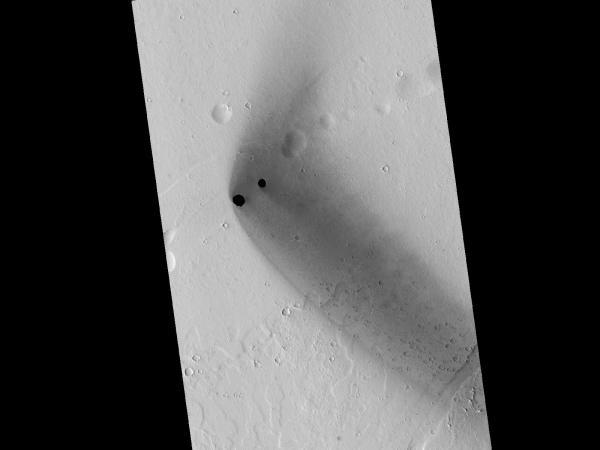 Mars Reconnaissance Orbiter - Dark Rimless Pits in the Tharsis Region