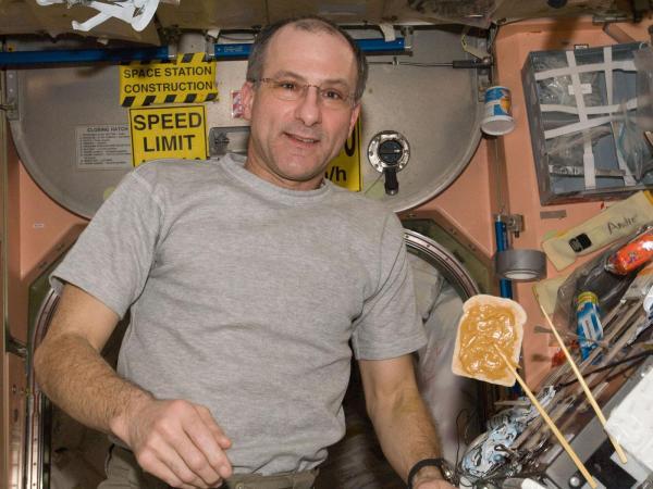 International Space Station - Astronaut Don Pettit Enjoys Snack