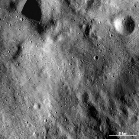 Vesta - Surface covered by regolith and fresh young impacts
