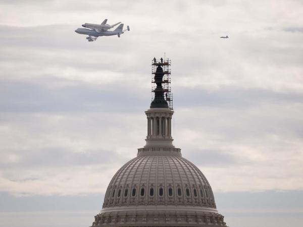 Discovery's Last Voyage - Space Shuttle Discovery Flown Over the U.S. Capitol