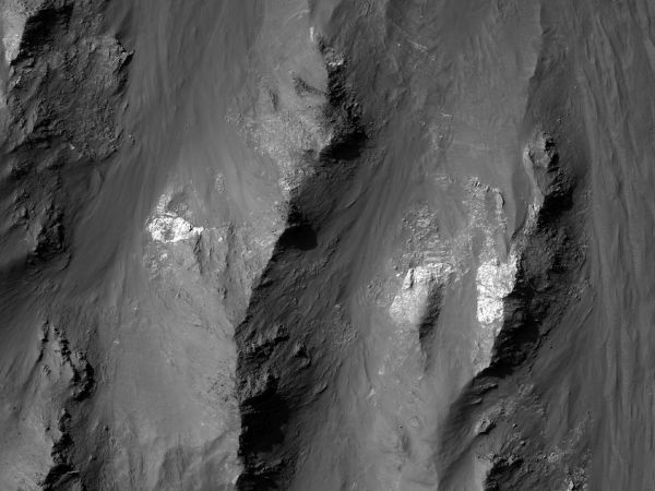 Mars Reconnaissance Orbiter - Different Materials Exposed along a Wallrock Slope in Coprates Chasma