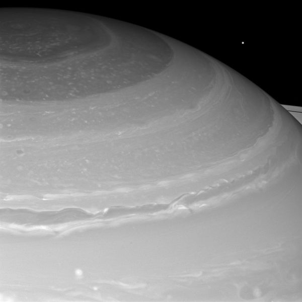 Mimas Peeks Over Saturn