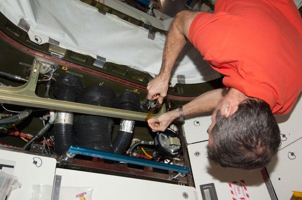 Astronaut Chris Hadfield Installs Sensor Kit