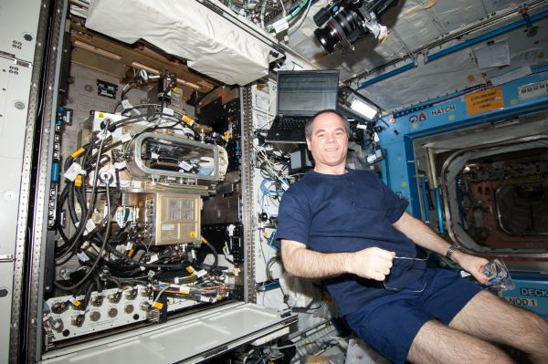 Commander Kevin Ford Sets Up Research Hardware